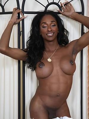 Beautiful black T-girl Natalia Coxxx stripping & teasing