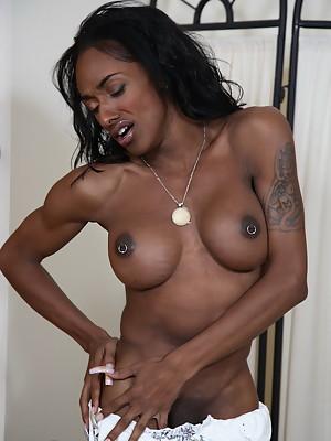 Beautiful black shemale Natalia Coxxx stripping & teasing