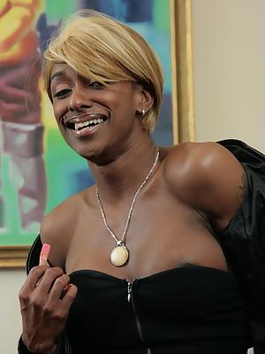 Blonde black t-girl Natalia Coxxx spreading her ass