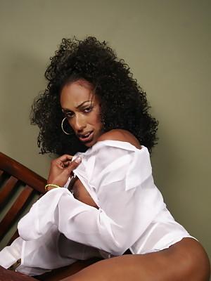 Horny black T-girl posing