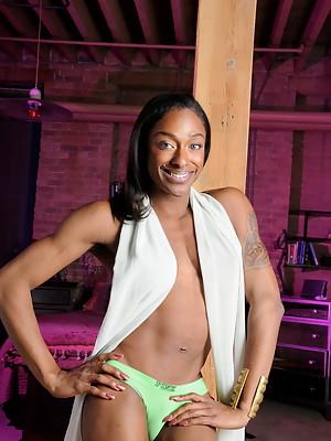 Super hot ebony transsexual Natalia Coxxx posing